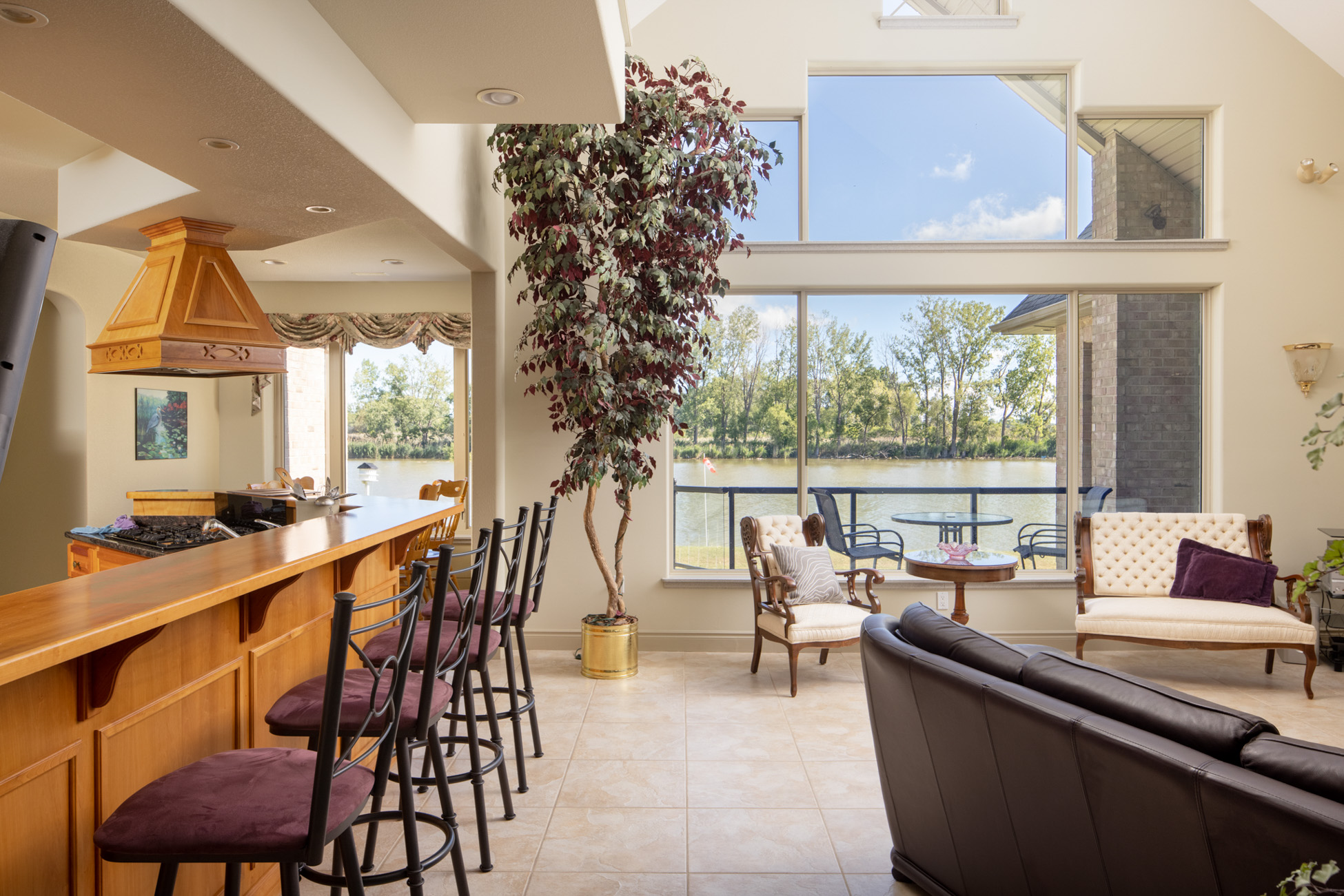 Living room interior with water view and eat-in kitchen island